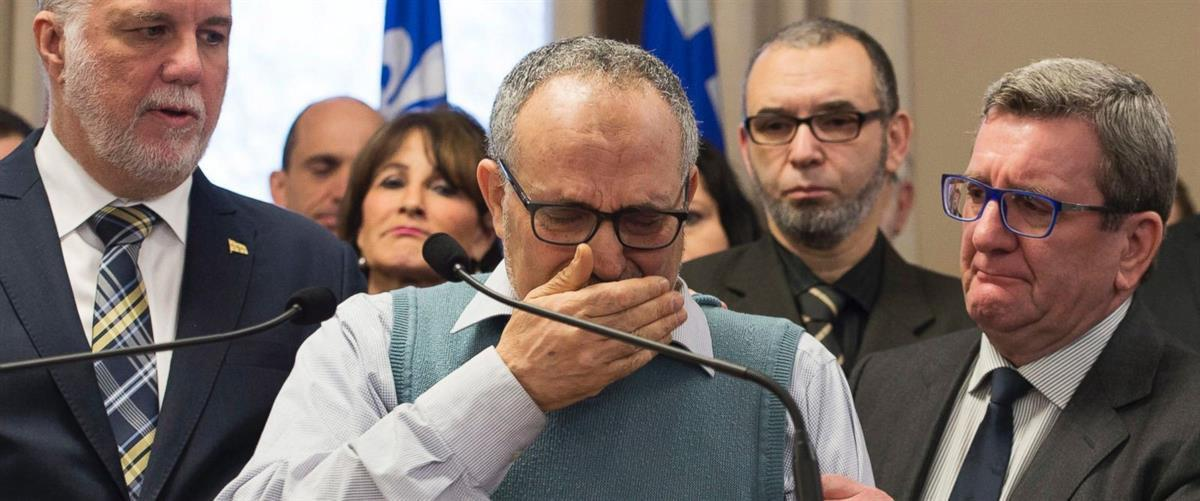 Centre culturel islamique de Québec vice-president Mohamed Labidi cries at a press conference with Quebec Premier Philippe Couillard, left, and Quebec City mayor Regis Labeaume, right (Jacques Boissinot / The Canadian Press).