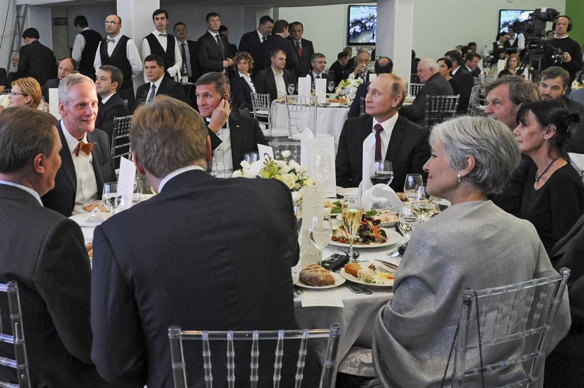 Thursday, Dec. 10, 2015, Russian President Vladimir Putin, center right, with retired U.S. Lt. Gen. Michael T. Flynn, center left. Michael Flynn was in attendance of the 10th anniversary of RT (the Russian government's propaganda network). Flynn acknowledged that he was paid to attend the event. And yes, that is former Green Party candidate Jill Stein (Mikhail Klimentyev/Sputnik, Kremlin Pool Photo via AP, file)