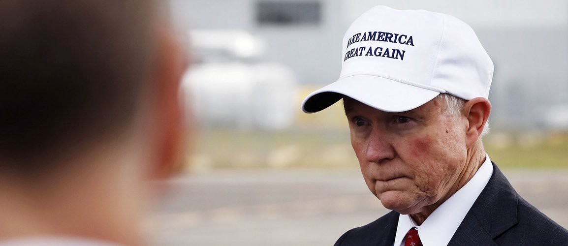 Jeff Sessions wearing a MAKE AMERICA GREAT AGAIN hat (Reuters)