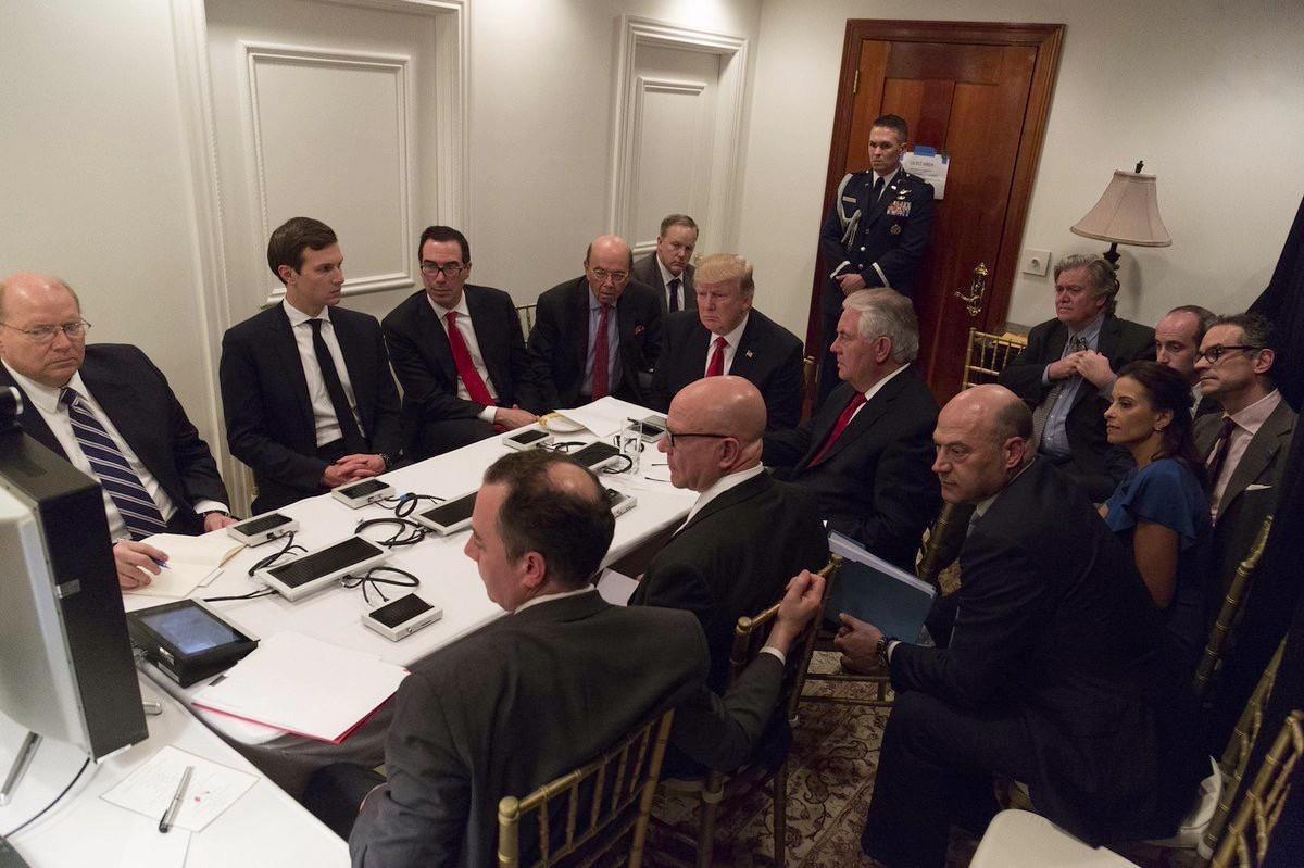President Donald Trump receives a briefing on the Syria military strike from his National Security team after the strike at Mar-a-Lago in Palm Beach, Fla., Thursday night, April 6, 2017. (White House via AP)