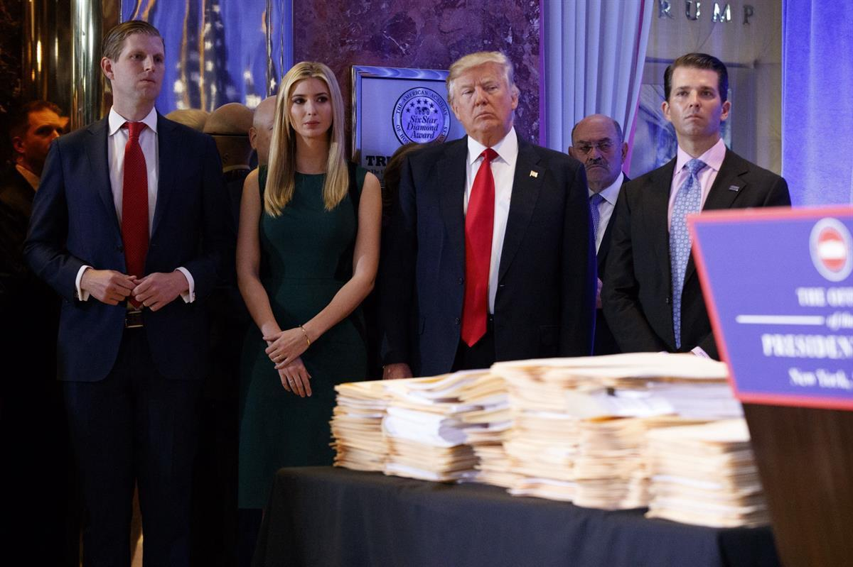 Donald Trump, accompanied by his family, at a news conference in the lobby of Trump Tower in New York Wednesday Jan. 11, 2017. (AP Photo/Evan Vucci)