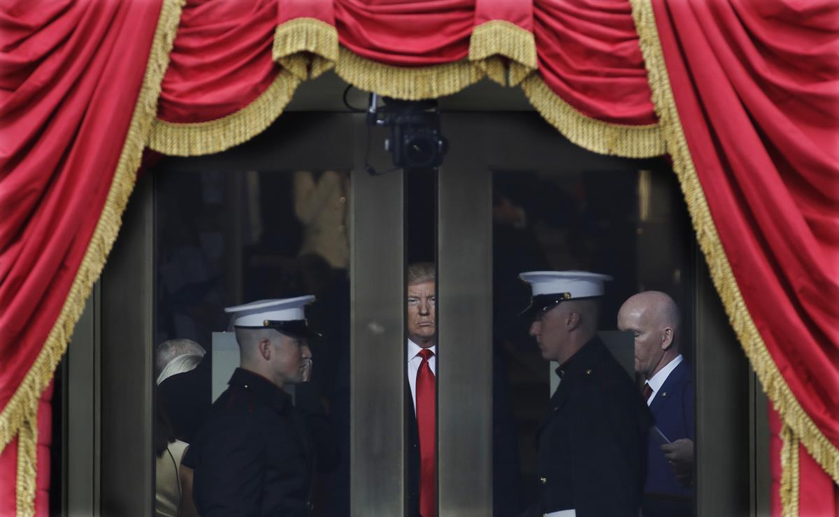 President-elect Donald Trump waits to step out onto the portico for his Presidential Inauguration at the U.S. Capitol in Washington, Friday, Jan. 20, 2017. (AP Photo/Patrick Semansky)