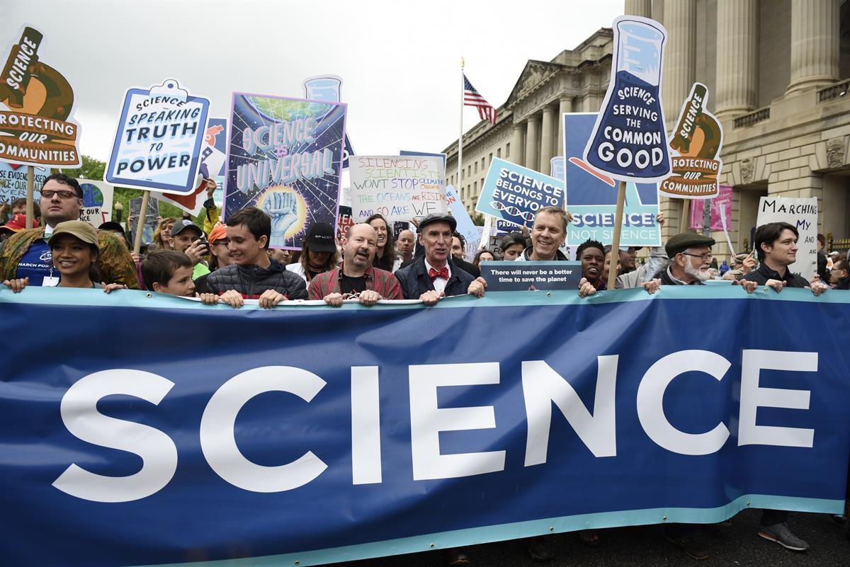 Protestors (including Bill Nye) carry a banner and signs as they pass the U.S. Environmental Protection Agency during the March For Science in Washington—Saturday, April 22, 2017 (AP Photo/Sait SerkanGurbuz)
