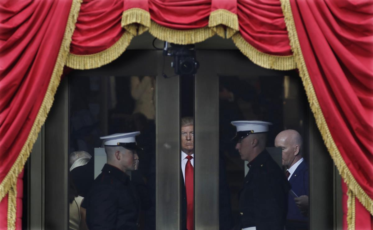 Donald Trump waits to step out onto the portico for his Presidential Inauguration at the U.S. Capitol in Washington — Friday, Jan. 20, 2017. (AP Photo/Patrick Semansky)