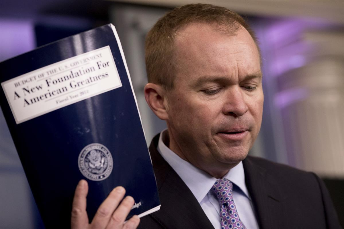 Budget Director Mick Mulvaney holds up a copy of President Donald Trump's proposed fiscal 2018 federal budget — Tuesday, May 23, 2017. (AP Photo/Andrew Harnik)
