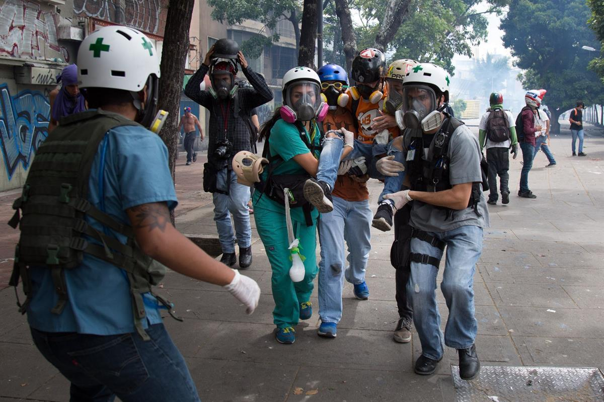 The Green Helmets carrying an injured patient for treatment (Photo by: <a href=