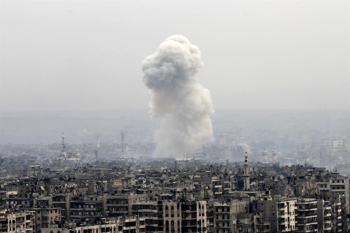 Smoke rises following a Syrian government air strike on rebel positions, in eastern Aleppo, Syria, Monday, Dec. 5, 2016. (AP/Hassan Ammar)