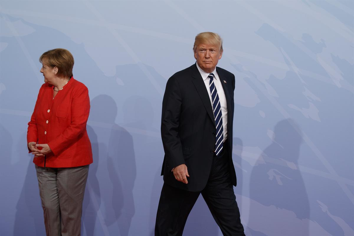 President Donald Trump walks off after being greeted by German Chancellor Angela Merkel after arriving at the G20 Summit, Friday, July 7, 2017, in Hamburg, Germany.—(AP/EvanVucci)