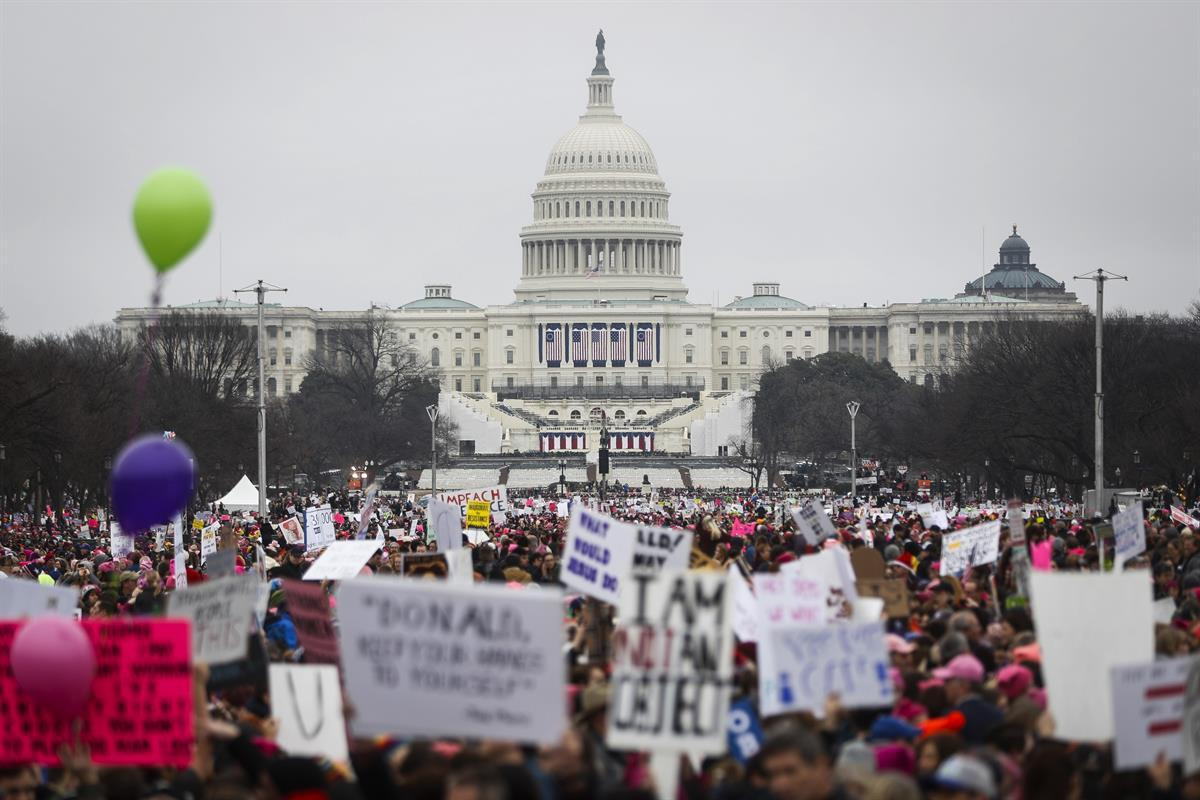 Protesters gather on the National Mall for the Women's March on Washington during the first full day of Donald Trump's presidency — Saturday, Jan. 21, 2017. (AP Photo/John Minchillo)