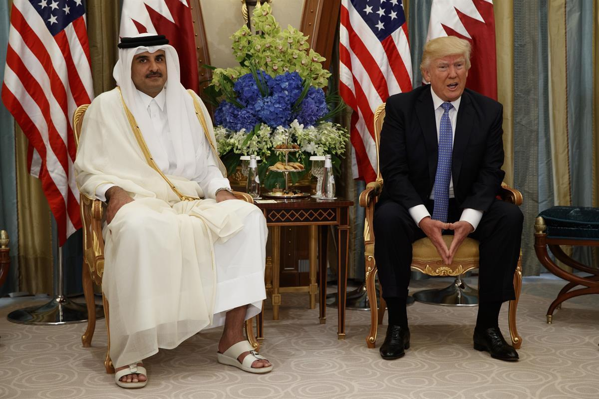 U.S. President Donald Trump, right, holds a bilateral meeting with Qatar's Emir Sheikh Tamim Bin Hamad Al-Thani, Sunday, May 21, 2017, in Riyadh. (AP Photo/Evan Vucci)