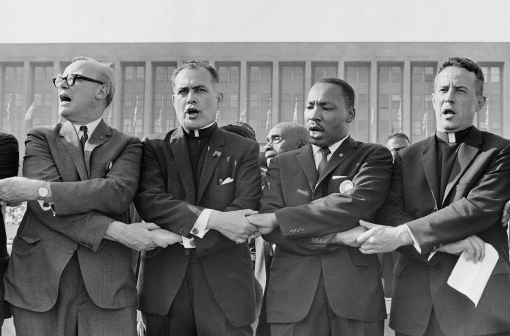 Rev. Theodore M. Hesburgh with Martin Luther King Jr., Rev. Edgar Chandler (far left), and Msgr. Robert J. Hagarty of Chicago (far right) at the Illinois Rally for Civil Rights in Chicago's Soldier Field,1964