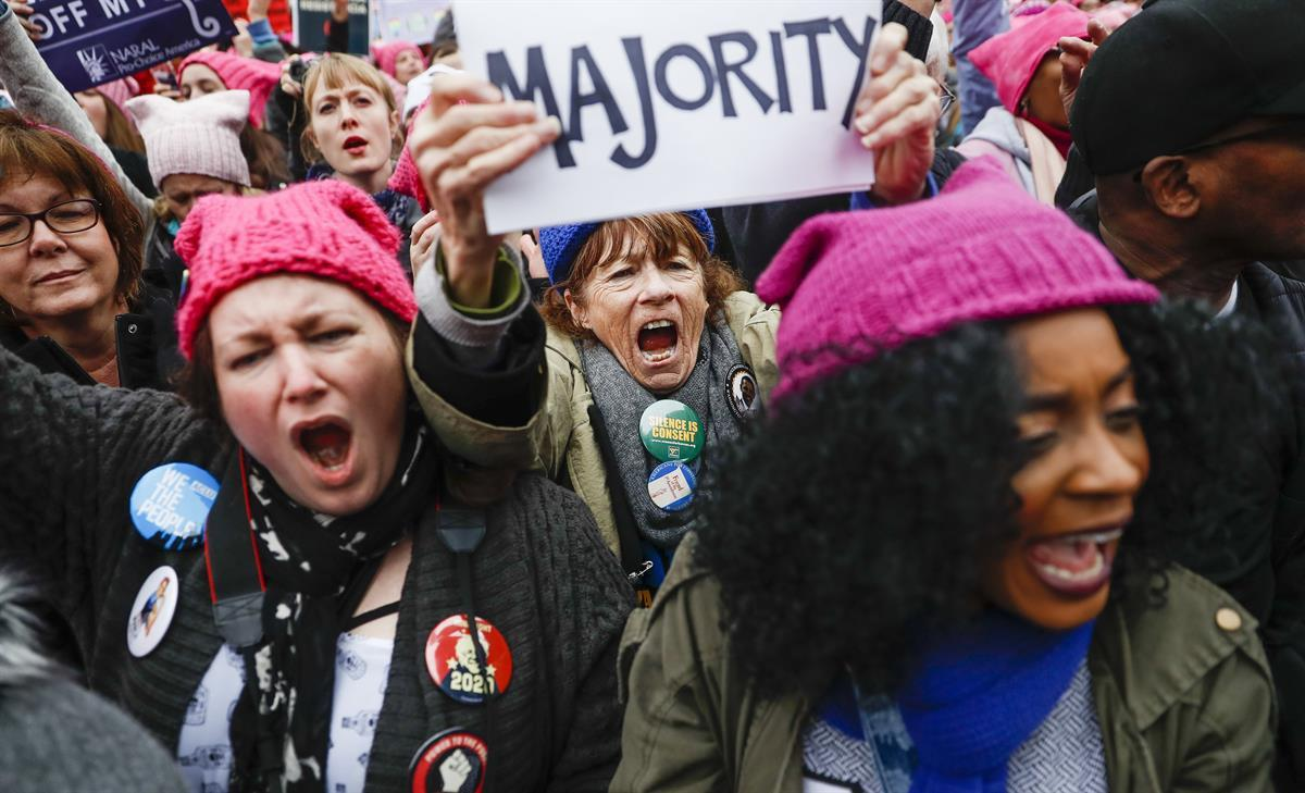 Protesters cheer at the Women's March on Washington during the first full day of Donald Trump's presidency, Saturday, Jan. 21, 2017 in Washington?—?(AP Photo/John Minchillo)