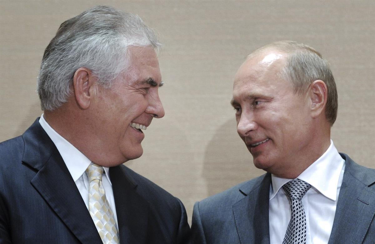 Rex Tillerson and Vladimir Putin during a signing ceremony in the Black Sea resort of Sochi, Russia, Aug. 30, 2011. (AP photo/RIA Novosti, Alexei Druzhinin, pool)