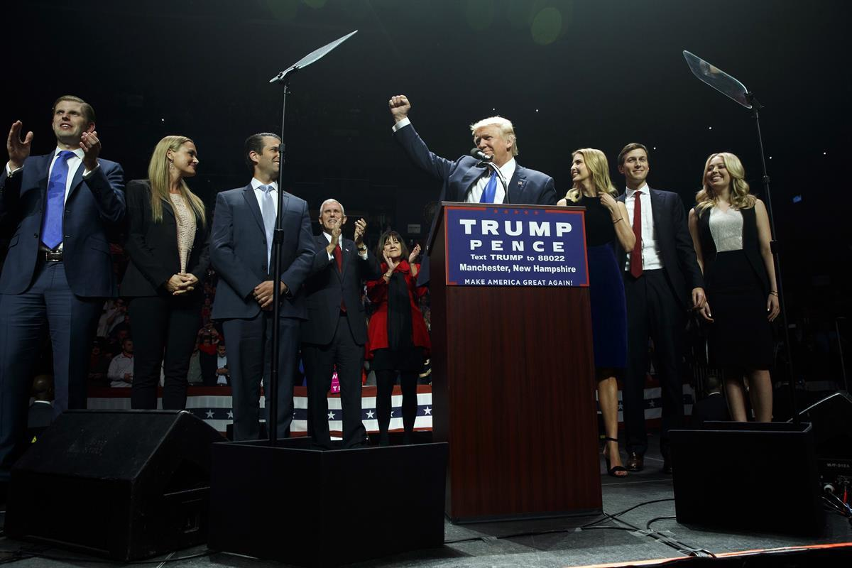 Donald Trump pumps his fist as he arrives to speak during a campaign rally on Nov. 7, 2016. From left are Eric Trump, Vanessa Trump, Donald Trump Jr., Vice President Mike Pence, Karen Pence, Ivanka Trump, Jared Kushner, and Tiffany Trump. (AP Photo/ EvanVucci)