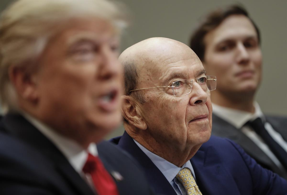 Commerce Secretary Wilbur Ross, center, listens to President Donald Trump during a meeting with House and Senate legislators in the Roosevelt Room of the White House in Washington, Thursday, Feb. 2, 2017. At right is White House Senior Adviser Jared Kushner. (AP Photo/Pablo Martinez Monsivais)