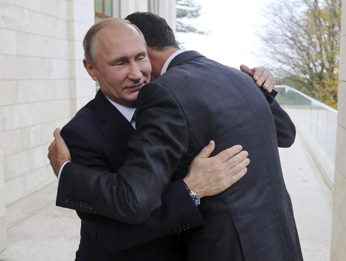 Russian President Vladimir Putin, left, embraces Syrian President Bashar Assad in the Bocharov Ruchei residence in the Black Sea resort of Sochi, Russia — Nov. 20, 2017 (Mikhail Klimentyev, Kremlin Pool Photo via AP)