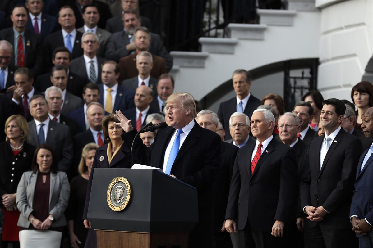 President Donald Trump, with Republican leaders behind him, speaks during the tax bill passage event on the South Lawn of the White House—Wednesday, Dec. 20, 2017 (AP Photo/Evan Vucci)