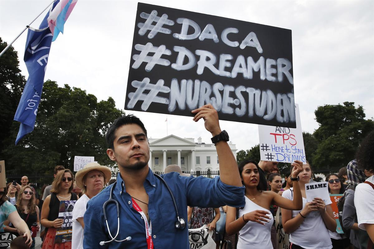 Carlos Esteban, 31, of Woodbridge, Va., a nursing student and recipient of Deferred Action for Childhood Arrivals, known as DACA, rallies with others in support of DACA outside of the White House, in Washington — Sept. 5, 2017 (AP Photo/Jacquelyn Martin)