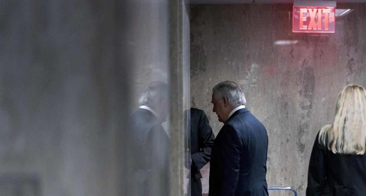 Rex Tillerson walks down a hallway after his final speech as Secretary of State at the State Department in Washington, Tuesday, March 13, 2018. (AP Photo/Andrew Harnik)