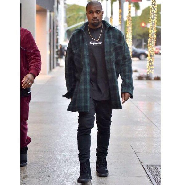 kanye-west-wearing-strapless-adidas-yeezy-boost-750-black_nzmwbt
