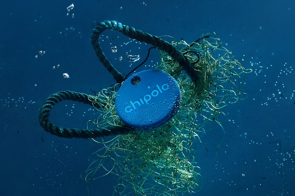 Chipolo One: Ocean Edition tangled in nets and floating in the water