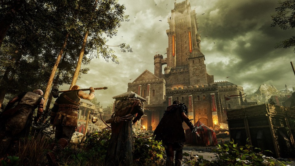 A towering fort building with the four main characters stealthily approaching through the undergrowth.  Hood: Outlaws & Legends Xbox One Review Rapid Reviews UK