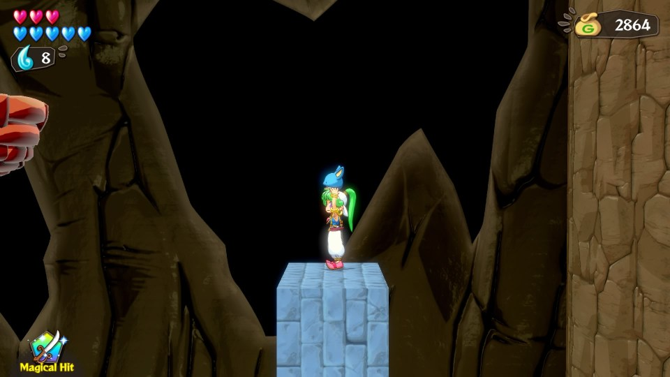 The player in a cave environment standing atop a blue brick cube