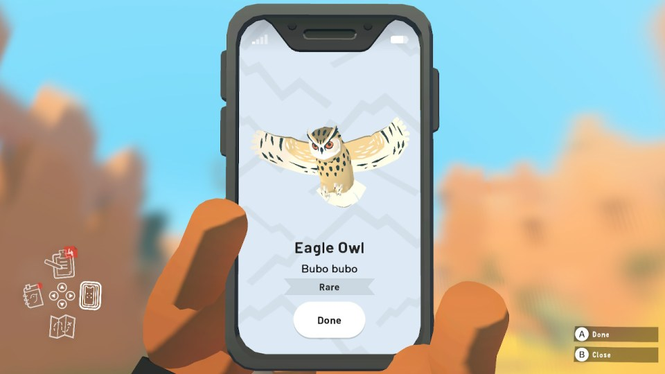 A mobile phone with an image of an Eagle Owl on the screen