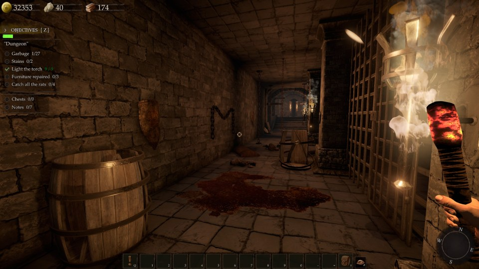 A messy dungeon with blood stains on the floor, and your character's hand holding a lit torch to the right.