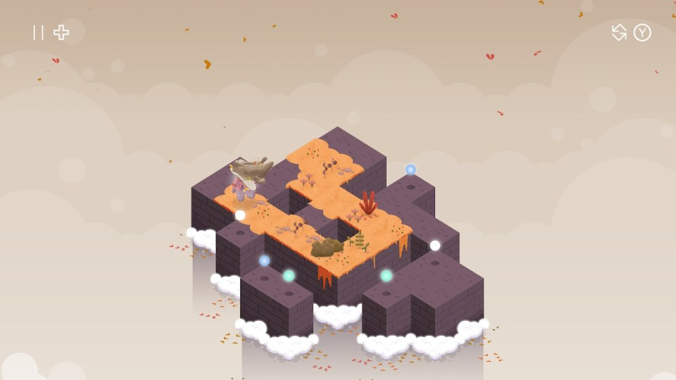 The player character leaves a trail of orange leaves across one of the puzzle stages