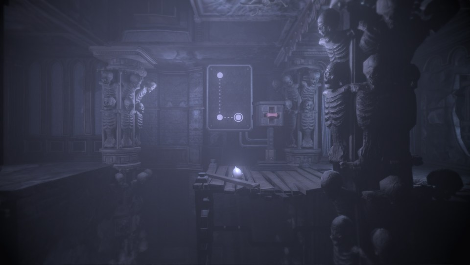 Skeletons in the background and foreground, a platform in the centre with a switch