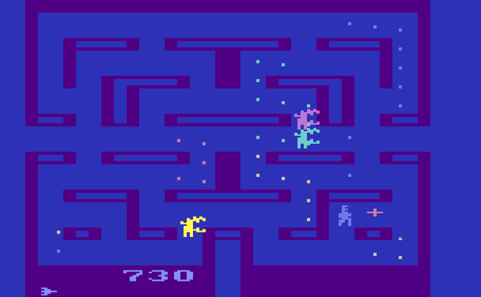 A 2D PAC-MAN style maze is shown, with the player sprite being chased by three other alien sprites.