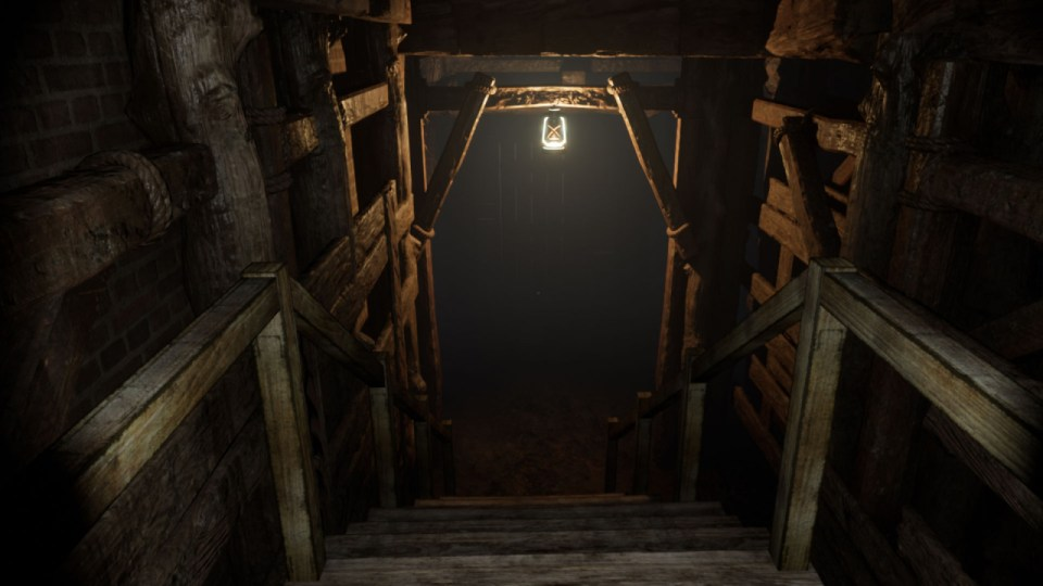 A set of descending stairs with a singular bulb looming over the entrance to a mine.  Horror Story: Hallowseed Early Access Review on PC