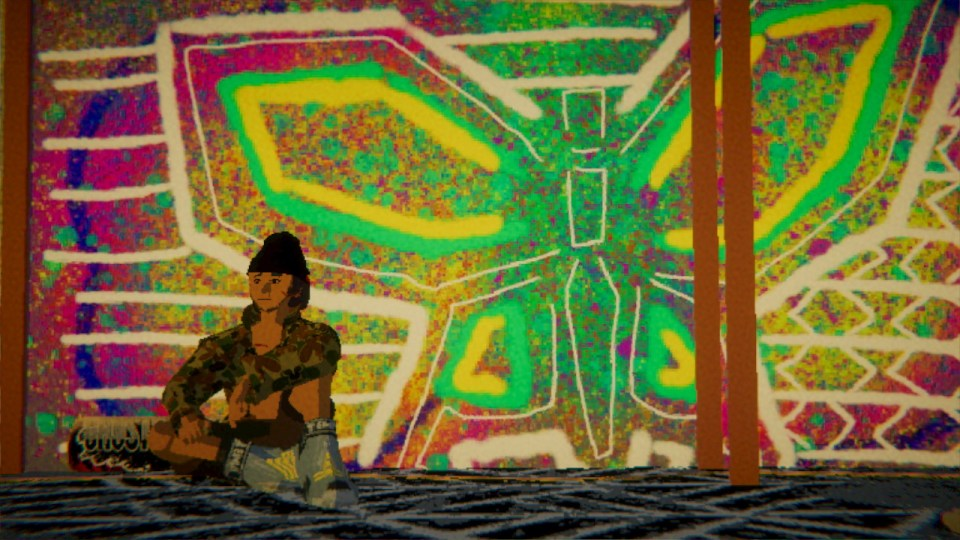 Man sat contemplating against a wall decorated with graffiti of a beautiful, bright butterfly.