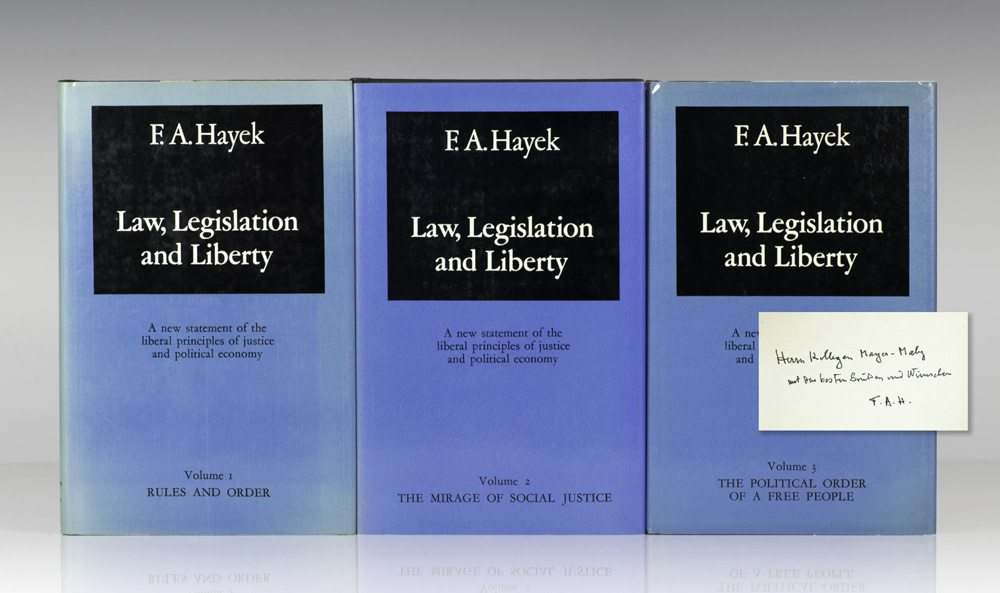 First editions of Law, Legislation and Liberty; volume I inscribed by Hayek