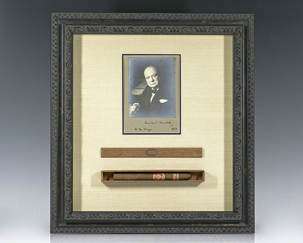 Original black and white photograph of Winston S. Churchill inscribed by him and accompanied by an exceptionally rare unsmoked Winston S. Churchill brand La Corona Cigar