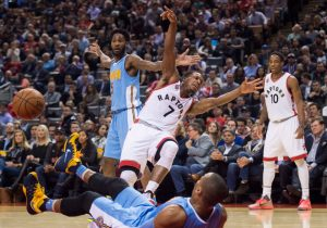 Toronto Raptors guard Kyle Lowry (7) loses the ball next to Denver Nuggets guard Randy Foye (4) as Nuggets' Will Barton (5) looks on during the first half of an NBA basketball game in Toronto, Thursday, Dec. 3, 2015 (Nathan Denette/The Canadian Press via AP) MANDATORY CREDIT