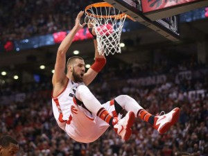 Jonas Valanciunas had all the rebounds in the first half but eventually fouled out of the game. Tom Szczerbowski / Getty Images