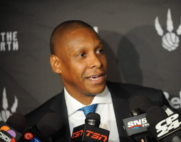 Sep 29, 2014; Toronto, Ontario, CAN; Toronto Raptors general manager Masai Ujiri during a media scrum at Raptors Media Day at The Real Sports Bar Toronto. Mandatory Credit: Peter Llewellyn-USA TODAY Sports