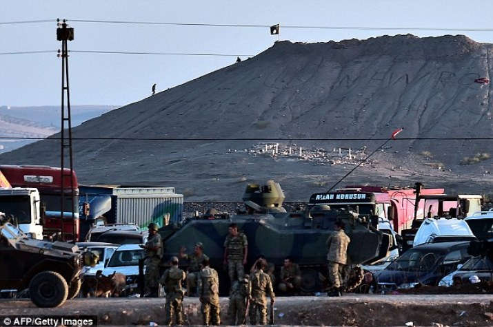 Last October ISIS militants were seen raising their black flag on a hill close to Kobane and the Turkish border while Turkish soldiers stood helpless in the foreground. Kurdish resistance troops have since torn down the flag and recaptured the hill in a symbolic victory