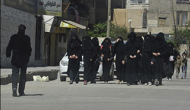 Brutal: Local activist group Raqqa is Being Slaughtered Silently claims ISIS' first act on seizing control of the city last year was to 'crack down on women' and to launch a 'vigorous search by ISIS fighters for wives'