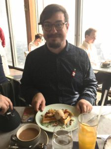 Ed with his tea and a toffee apple waffle at Duck & Waffle