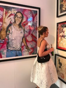 Browsing the art gallery at Henley Festival