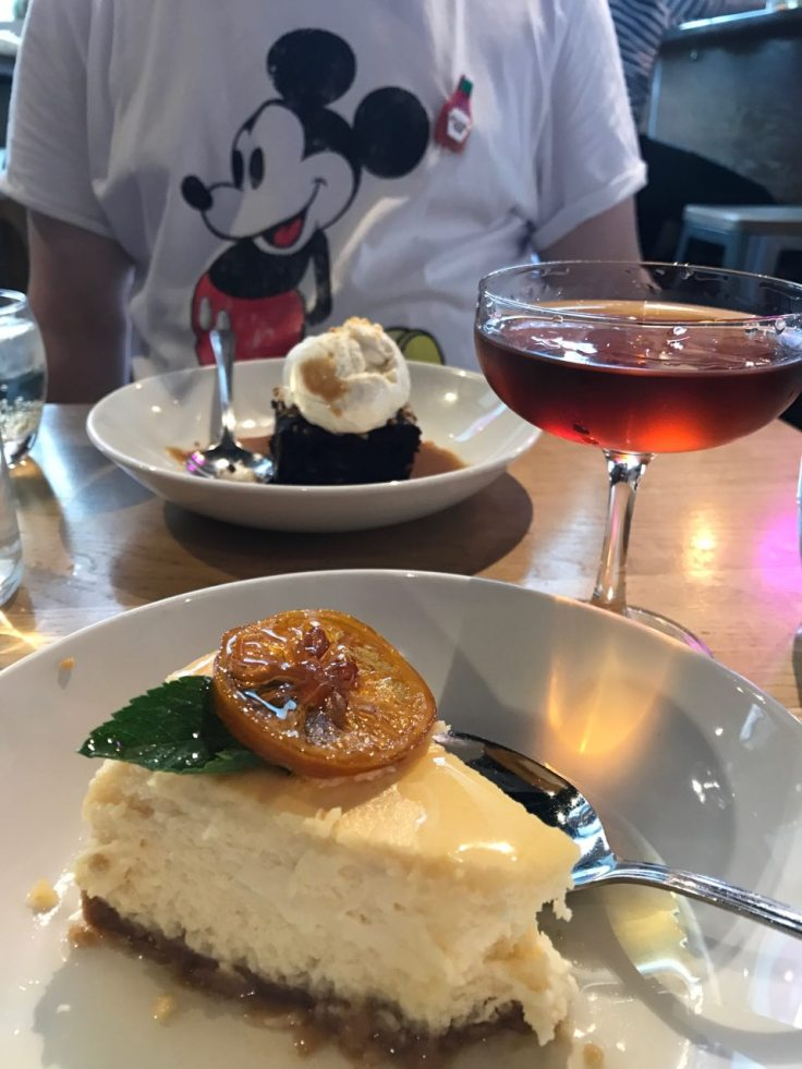 Lori's cheesecake and cocktail, plus Ed's brownie and excellent t-shirt!