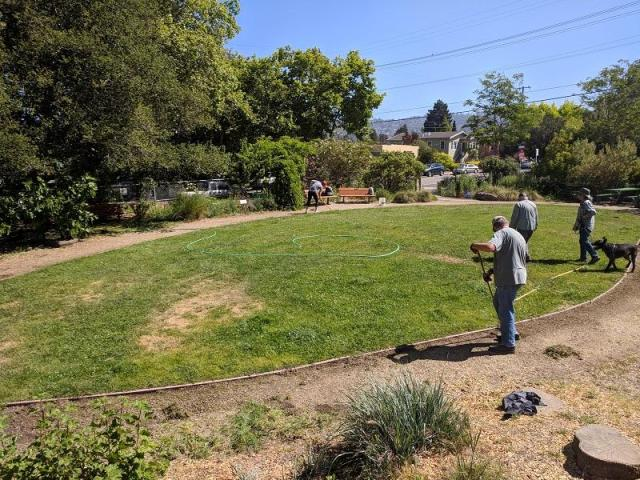 Volunteers maintain the Schoolhouse Creek Commons Park at the corner of Curtis and Virginia Streets.