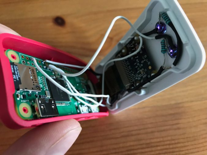 A close up of the circuit inside the Raspberry Pi case, showing where the wires were soldered to the Pi's G P I O pins.