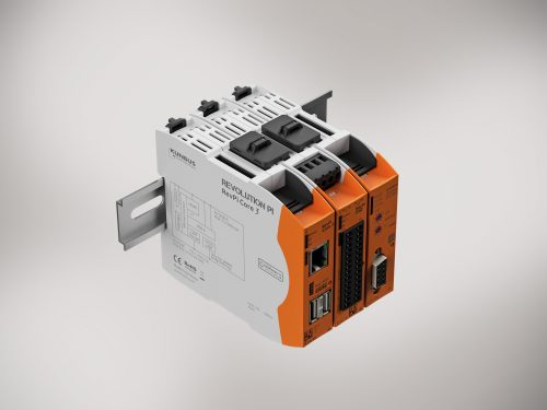 Three smart, compact orange and grey RevPi Core 3 enclosures mounted on a din rail