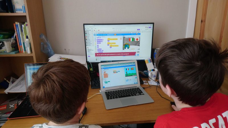 Two kids doing digital making at home