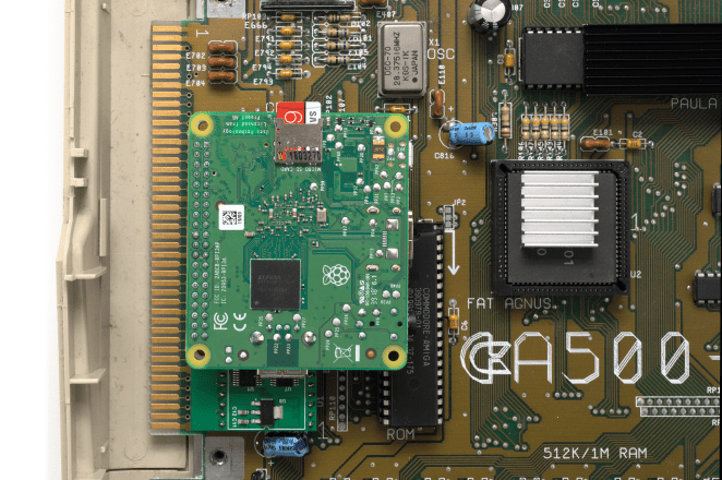 A Raspberry Pi 3 Model A+ connects to the PiStorm via its GPIO header