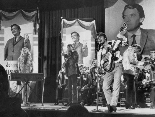 Streets Part 1: photo of Max Frost and band on stage from the movie WILD IN THE STREETS.
